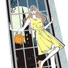 ハロウィン・かぼちゃを持って窓辺に立つ女の子